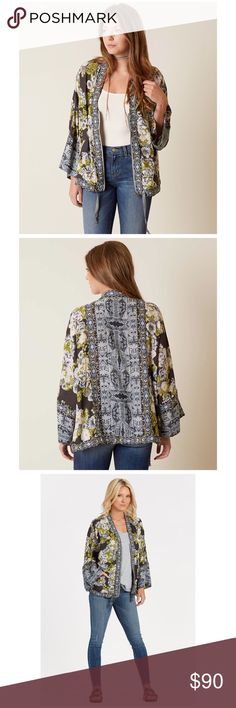 """Free People Wildflower Kimono Jacket A kimono-inspired Free People jacket with a lavish floral pattern. The V neckline dips to an exposed zip closure. Drawstring waist. Loose sleeves. Unlined.  Fabric: Crepe. Shell: 100% polyester. Trim: 100% nylon. Hand wash or dry clean. Measurements Length: 27"""" from shoulder. Loose fit. 🚫 No trades Free People Jackets & Coats"""
