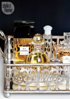 Use an antique mirrored tray to display perfumes.