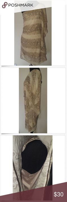 """Bebe Beige Snakeskin Print One Shoulder Silk Dress Bebe Sz M Beige Snakeskin Print One Shoulder Ruffle Trim Silk Dress  Size Medium Good condition, near zipper dress shows some minimal signs of wear. Some minor pulled/pinched threads. Beige, snakeskin print, one shoulder, ruffle trim on sleeve and down left side, right side zippers Bust: 301/2"""" Sleeve: 18 1/2"""" Length: 28"""" Imported Ships from Smoke-Free Home  Thanks for stopping by! bebe Dresses One Shoulder"""