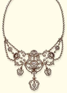 AN ANTIQUE DIAMOND NECKLACE. Designed as a series of openwork floral clusters and collets suspending three pendants to the diamond line backchain, central section detachable, mounted in silver and gold, circa 1890. #antique #Victorian #necklace