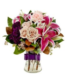 The Perfect Winter Romance Bouquet: pink stargazer lilies, cream roses, and purple carnations