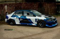 https://flic.kr/p/s8DTR7   Monsterous Evo 8 Race car camo wrap   100% Racecar, no messing about. Now with a bit more of a presence on track and on show with a custom distraction camo designed wrap
