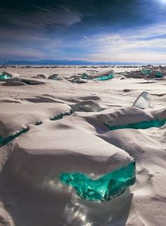 the frozen turquoise ice at lake baikal, russia