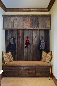 Custom built-in barnwood coat rack and bench.This beautiful completely custom home is located on the Gorge side of 221S in Blowing Rock. Talk about fantastic, long range views and rustic mountain elegance! - VPC Builders