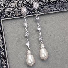 Long Pearl Dangle Earrings, Bridal Pearl Drop Earrings, Teardrop Pearl Earrings, Wedding Jewelry, Pearl and Rhinestone. $66.00, via Etsy.