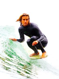 Alex Knost, surfing time-traveller. Toes on the noes in Malibu, California.