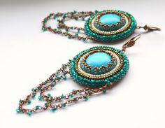 Bead embroidered earrings by DreamsofCharlotte via Etsy. Loving the dangling chains from the bottoms