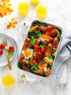 Perfect for brekky on Christmas morning, and a great way to put the ciabatta to good use in a delicious recipe. Tomato Breakfast, Breakfast Strata, Egg Recipes For Breakfast, Vegetarian Recipes, Strata Recipes, Tray Bake Recipes, Cherry Tomato Recipes, Roasted Cherry Tomatoes, Recipes