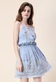 This embroidered cami dress is going to be a breath of fresh flair to your spring dress collection. Step out in flats and a cardigan for a look that's both simple yet elegant.  - Floral embroidery - Deep v-shape wrapped front - Elastic waistband - Lined - 100% Polyester - Hand wash cold  Size(cm) Length Bust Waist  S          90    88   46-68    M &nb...