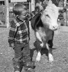 farm boy with calf ---> future kid:) a boy and his hereford:)