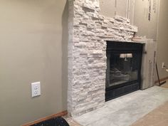 A diy stone veneer installation step by step stone veneer stone fireplacechimney mke tile stone we can remove your old or brick veneer and put up something more contemporary like this ledgestone home decorations home solutioingenieria Choice Image