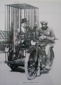 1920s: Harley Davidson Mobile Booking Cage...