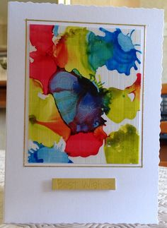 Alcohol inks, dripped then blown to spread. Mounted on linen textured board, using snopake roller adhesive. Trimmed then mounted onto card blank. Frame using peel offs and add sentiment.