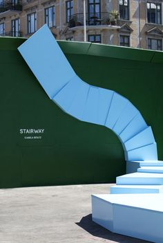 Public space installation Stairway by Izabela Boloz in Copenhagen. Stairway is an urban sculpture resembling a surrealistic staircase which creates an urban meeting spot. #publicspace #architecture #installation #izabelaboloz #streetfurniture #art