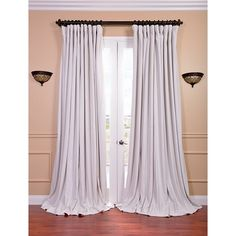 Give any room a dramatic makeover when you hang this extra-wide curtain panel. The velvet texture and off-white color give extra depth and style to any room, while the convenient blackout lining keeps light out in the wee hours of the morning.