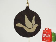 Beautiful Marquetry wood inlay Christmas ornament of Dove. Inlay woods is Holly and background wood is American Walnut. Please note: Brass wire stand