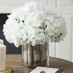 Laurel Foundry Modern Farmhouse Add a pop of natural appeal to your entryway console or powder room vanity with this faux hydrangea, showcasing lush white blooms nestled in a birch wood pot.