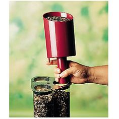 Bird Seed Scoop & Funnel - I have a similar type scoop and love it! It has a damper on it to start and stop the seed flow.