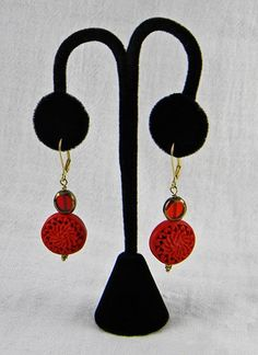 This pair of red and gold earrings are picture perfect for and casual event wardrobe.  Going to a garden party?  Wear flowers on your ears.  These large red Chrysanthemum disks give that touch of flor