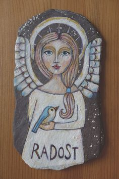 Angel painted on stone. Inspired by Teresa Kogut