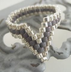 Items similar to Womens Finger Tip Ring or Toe Ring Geometric Lavender and Chrome woven seed bead ring Hand woven beaded ring Fashion rings for summer on Etsy fashion summer Vintage Gold Engagement Rings, Shop Engagement Rings, Rose Gold Engagement Ring, Jewelry Patterns, Bracelet Patterns, Beaded Rings, Beaded Jewelry, Jewelry Bracelets, Bead Earrings