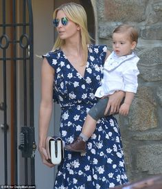 Shady: She paired her dress with matching blue shades from Ray-Ban, and carried a blue, wh...