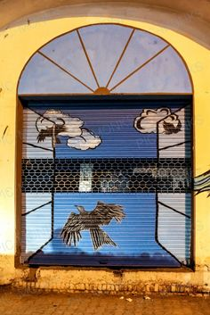Amazing street art from India depicting the flight of freedom of a few birds, out of a window.