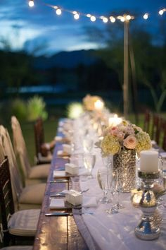 Inspired Design - Such a pretty and soft table with silver accents and pale flowers on a beautiful evening. Love the lighting.