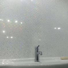 White Sparkle is a white gloss panel with small reflective sparkle pieces which flitter and sparkle in the light creating a dazzling rainbow effect. The panels are tongue & groove for easy installation as well as being waterproof and stain resistant. Bathroom Shower Panels, Pvc Bathroom Cladding, Bathroom Paneling, Cladding Panels, Wall Cladding, Glitter Bathroom, Pvc Wall Panels, Bathroom Inspiration, Bathroom Ideas