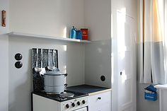Bruno Taut House / Berlin, Germany / kitchen, stove, white, black, blue, red, grey, cream