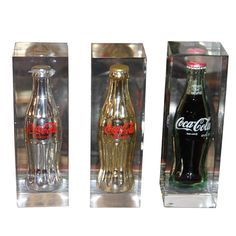 Collection of Coke bottles in Lucite | From a unique collection of antique and modern sculptures at http://www.1stdibs.com/furniture/more-furniture-collectibles/sculptures/