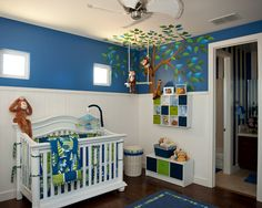 Jungle theme nursery with cool yet vibrant colors.