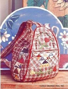 Несколько лет назад попалась вот такая картинка рюкзачка.  Понравился (да он мне и сейчас нравится) и своим оформлением, и формой.  Захотело...