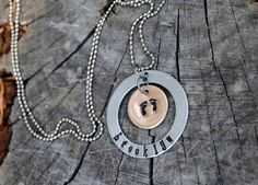 Baby Feet Metal Hand Stamped Necklace. $25.00, via Etsy.