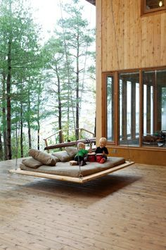 Lovenordic Design Blog: Family home by the lake near Toronto: Love the swinging couch.