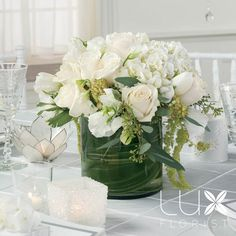 White Centerpiece (roses, lisianthus, hydrangea, ginger plant leaves in the container) reception wedding flowers,  wedding decor, wedding flower centerpiece, wedding flower arrangement, add pic source on comment and we will update it. www.myfloweraffair.com can create this beautiful wedding flower look.
