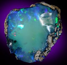 Opal (var. Crystal Fire Opal) from 570 km north of Addis Ababa, Wello (Wollo), Delanta Plateau, Tigray, Ethiopia
