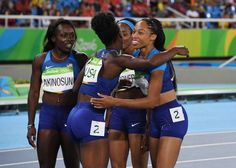Tianna Bartoletta , Allyson Felix , English Gardner and Morolake Akinosun (USA) after the women's 4x100m relay heats in the Rio 2016 Summer Olympic Games at Estadio Olimpico Joao Havelange.