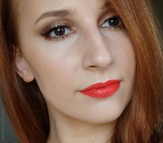 Copper gold shimmery summer makeup with orange lips
