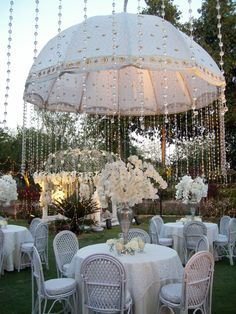 Outdoor wedding with hanging crystals from umbrellas (picture only)