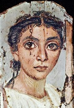 Encaustic mummy portrait, 2nd to 3rd c. AD, from Ar-Rubayat in the Fayyum, Egypt. A young woman with large eyes; her hair is parted in the middle and worn loosely pulled back.