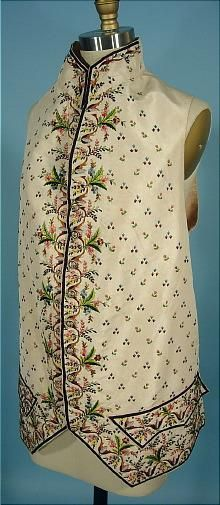 Waistcoat, Habit à la Francaise (court frock coat and waistcoat), France 1770-1790s. Frock coat: dark taupe cut velvet, lavishly embroidered with naturalistic flowers in polychrome silk; ivory silk faille waistcoat, embroidered with bright silk in a complementary floral design.