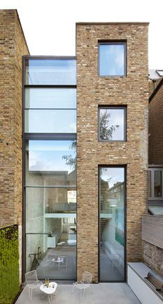 A Victorian terraced house in north London, converted once before in the 1980s, has been reshaped and extended by Studio Octopi. A 10m-high glass infill was slotted in beside the neighbouring wall to open up space for a double-height dining room and ne...