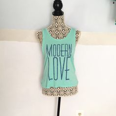 Modern Love tank Never worn. From Urban outfitters. Size small be can fit a small Junk Food Tops Muscle Tees