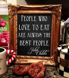 """People who love to eat are always the best people."" Julia Child sign by the buffet"