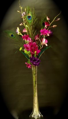 Centerpiece in an Eiffel Tower vase with purple orchids and lisianthus ...