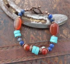 Orange agate, blue sodalite stone, turquoise stone and copper metal bracelet.