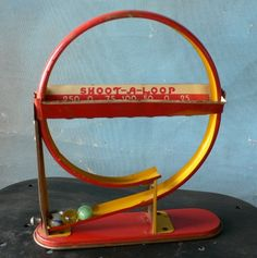 vintage tin toy Shoot-A-Loop marble shooting game red yellow