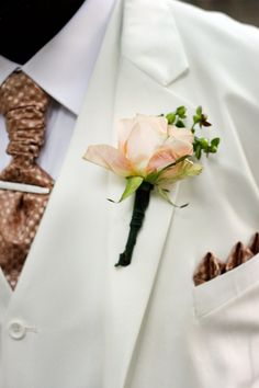 The boutonniere I made for an August wedding. [Photo copyright Jordan Hughes.]