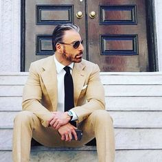A tan suit is essential for the season. A tan suit is essential for the season. sports it well. A tan suit is essential for the season. sports it well. Tan Suit Men, Mens Suits, Sharp Dressed Man, Well Dressed, Blue Suit Mens Fashion, Sugar Daddy Dating, Elegant Man, Simple Elegance, Church Attire